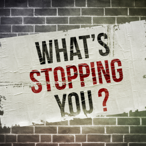 """Question: """"What's stopping you?"""" painted on brick wall"""